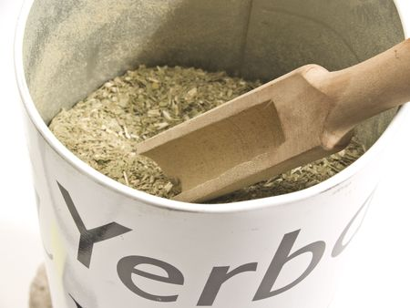 mate drink:  Dry Yerba Mate leaves on white background, traditional drink of Argentina.