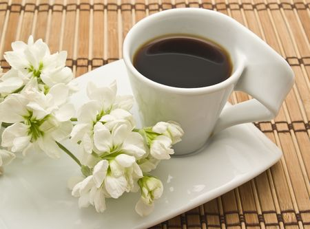 cup of coffee with flowers photo