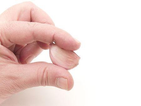 hand with garlic clove Stock Photo