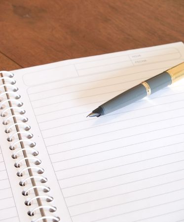 pen and notebook photo