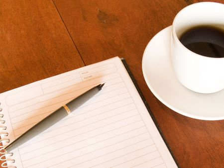 notebook, pen and coffee cup photo