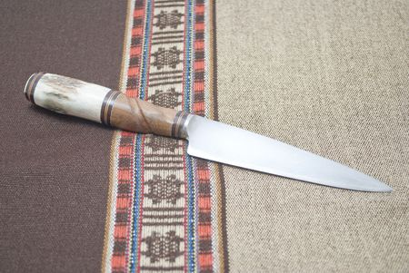 knife on poncho photo