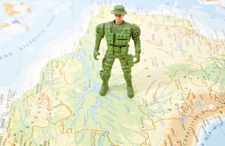 conceptually: toy soldier on world map