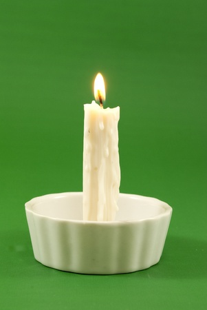 white candle lit Stock Photo - 8537400