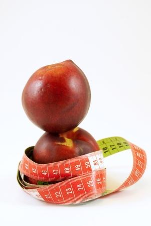 peach trees with metric tape photo