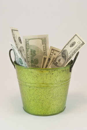 bucket with dollars photo