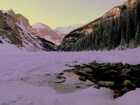 frozen lake: Frozen Lake Louise Stock Photo