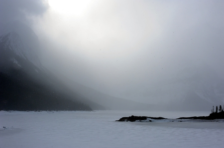 frozen lake: Storm rolls over the frozen lake of the Rocky Mountains Stock Photo
