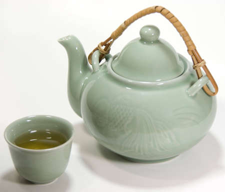 chinese teapot: Asian decorated tea set with green tea Stock Photo