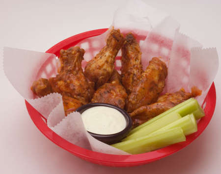hot wings: hot spicy buffalo chicken wings celery and bleu cheese Stock Photo