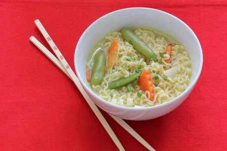 asian noodle soup bowl with chopsticks Imagens - 9195931