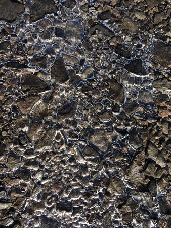 Frozen water between rocks