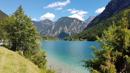 Mountain river in the Bavarian Alps. Low water, turquoise water, stony riverbed, clear summer day