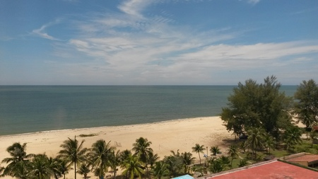 Sandy beach and blue sea under the blue sky in Terengganu, Malaysia, a great sight to behold
