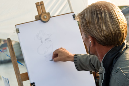 parody: Artist drawing a portrait