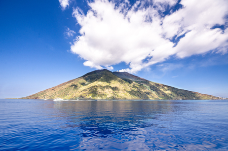 eruptive: View from the boat to an island of Sicily on a sunny day Stock Photo