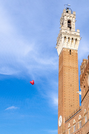 Heart baloon in the center of Siena, near bell tower Piazza del campo Stock Photo