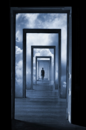 brain mysteries: Silhouette in a corridor in front of a closed door  Rite of passage concept  Linear perspective view through several open doors and empty rooms