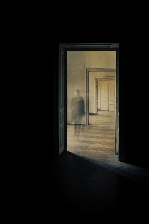 view through door: Silhouette in a corridor approaching  Closed door at the end of the hallway   Linear perspective view through several open doors and empty rooms