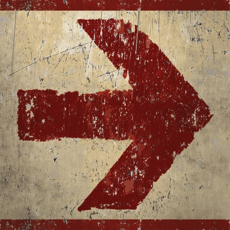 Red arrow sign painted in graffiti artwork style, artistic grunge design background Standard-Bild