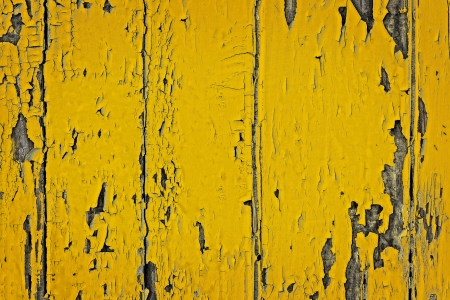 Grunge shabby background texture of yellow painted wooden board with peeling paint Archivio Fotografico