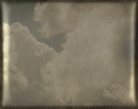 Shiny vintage background with sky and clouds  Soft and smooth leather texture with stitched frame  Framework design for your content