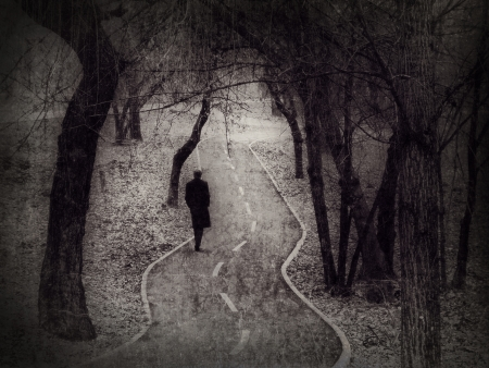 Lonely walk, rite of passage concept, metaphorical image edited in the antique  vintage  style