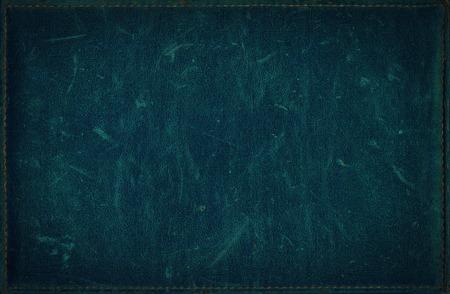 苦痛の革の質感から暗い青グランジ背景