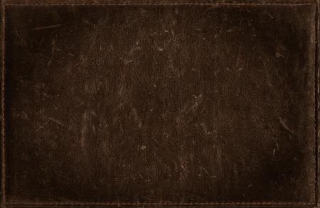 苦痛の革の質感から暗い茶色グランジ背景