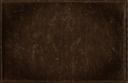 Dark brown grunge background from distress leather texture Imagens