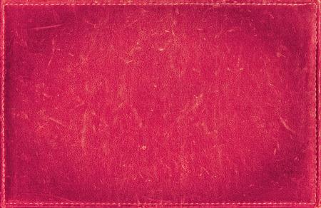 苦痛の革の質感からピンク グランジ背景