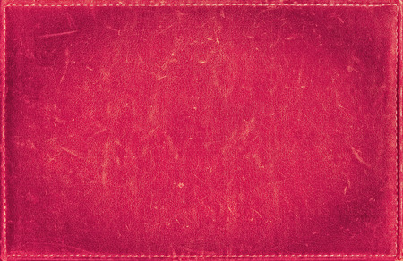 Pink grunge background from distress leather texture