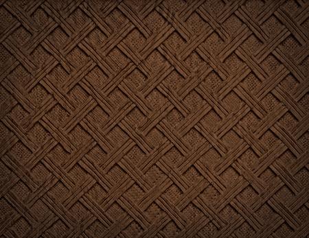 手作りの彫刻が施された木材のテクスチャから茶色の装飾的な背景