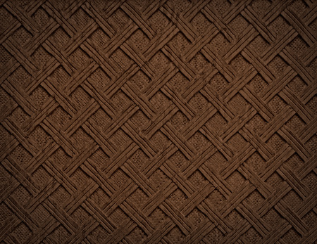 Brown decorative background from handmade carved wood texture