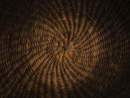 Dark brown grunge abstract background from circular wicker pattern texture Standard-Bild