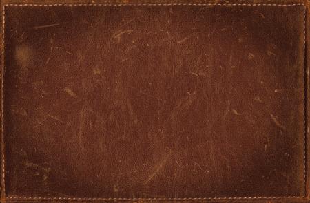 Brown grunge achtergrond van nood lederen textuur Stockfoto