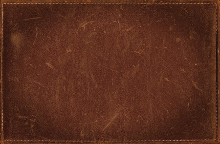 Brown grunge background from distress leather texture Imagens