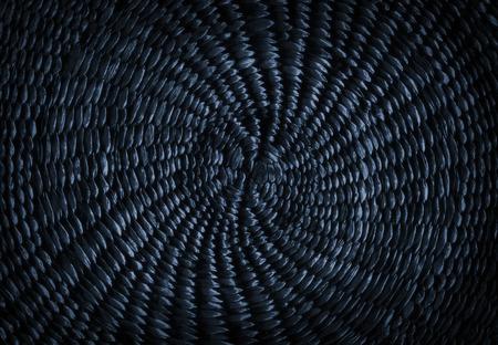 Dark blue grunge abstract background from circular wicker pattern texture