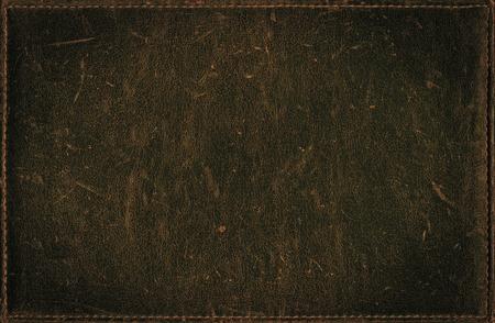 苦痛の革の質感から暗いグランジ背景