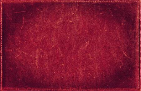 苦痛の革の質感から赤いグランジ背景 写真素材