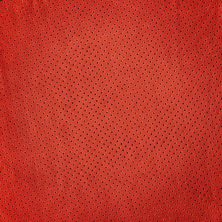 背景の赤い革の質感