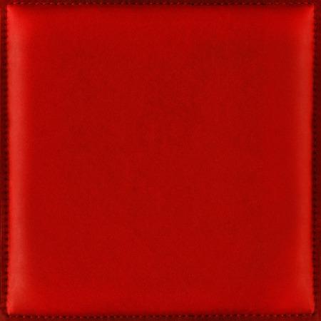 ソフトで滑らかな本革ステッチ フレームで、クリスマスと新年のグリーティング カードに適したから光沢のある赤い革背景、ロマンチックなとお祝
