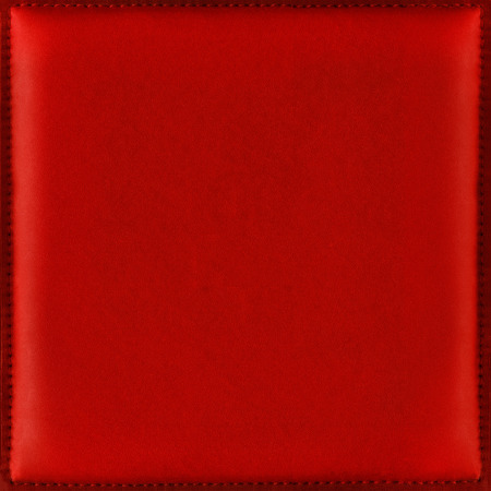 Shiny red leather background from natural soft and smooth leather with stitched frame, suitable for Christmas and New Year greeting cards, romantic and festive moments. Archivio Fotografico