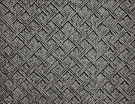Grey decorative grunge background from handmade carved wood texture photo