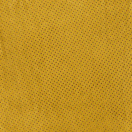背景の黄色い革の質感