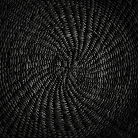 Black grunge abstract background from circular wicker pattern texture Archivio Fotografico