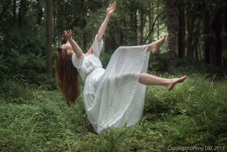 lady fly: Beautiful woman falling onto the forest Stock Photo