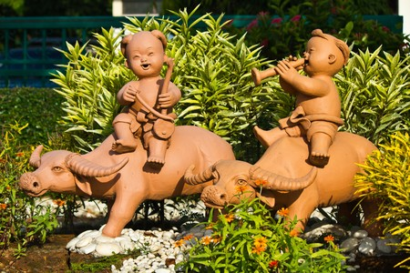 Earthenware Childs and Buffalo Stock Photo