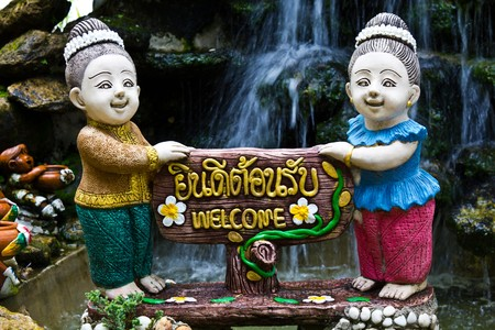 Thai woman holds the sign You're welcome