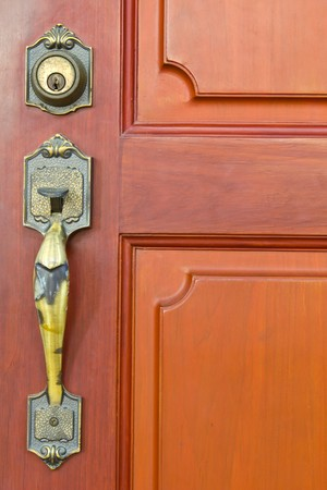 Single Door handle on old door painted with brown Stock Photo - 8074920
